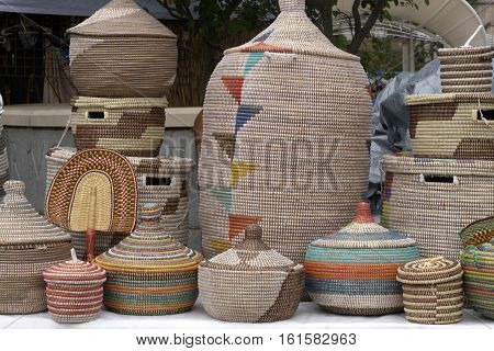 Asheville, North Carolina,USA - September 10 2016: A variety of colorfully woven artistic African baskets of different shapes and sizes for sale at a Goombay festival on September 10, 2016 in downtown Asheville, NC