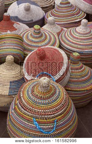Asheville North Carolina USA - September 10 2016: A variety of colorfully woven artistic African baskets with lids for sale at a Goombay festival on September 10 2016 in downtown Asheville NC