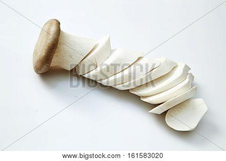 King oyster mushroom Pleurotus eryngii on white background sliced