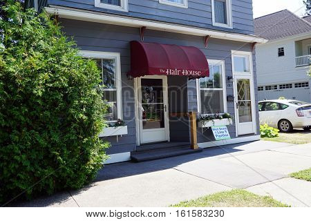 HARBOR SPRINGS, MICHIGAN / UNITED STATES - AUGUST 3, 2016: One may have one's hair cut at the Hair House near downtown Harbor Springs.