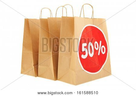 Brown paper shopping bags with 50% discount isolated over white background