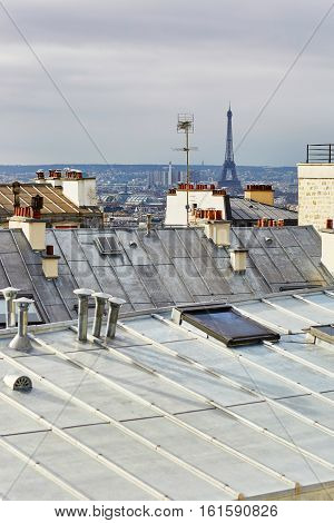 Scenic View Of Parisian Roofs And Eiffel Tower From Montmartre