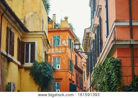 Colorful Yellow And Orange Buildings On A Street Of Rome