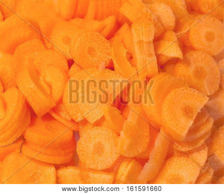 Sliced into slices raw carrots close-up .