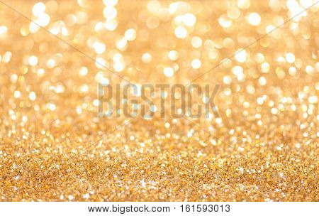 Abstract holidays golden sand and lights on background