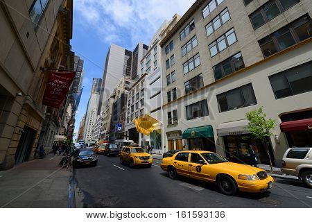 NEW YORK CITY - MAY 7, 2013: West 56th Street near Fifth Avenue in midtown Manhattan, New York City, USA.