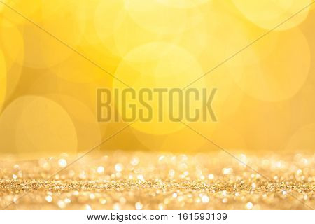 Abstract holidays golden sand and bokeh lights on background
