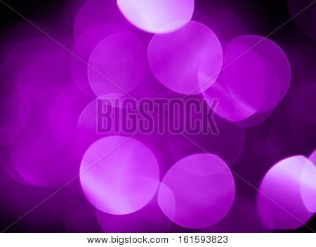 Pink blurred lights, bokeh effect. Real photo background. Isolated on black