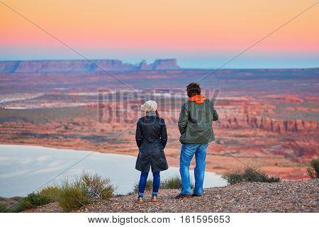 Couple Enjoying Breathtaking View Of Lake Powell In Arizona, Usa