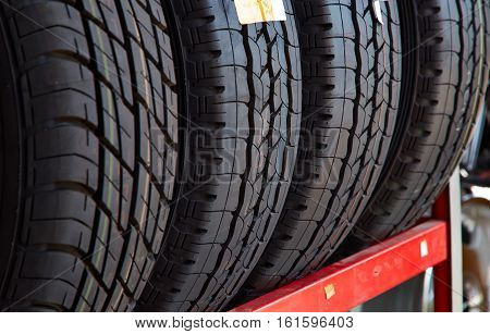 Car tires at warehouse in tire store New four tires Horizontal photography