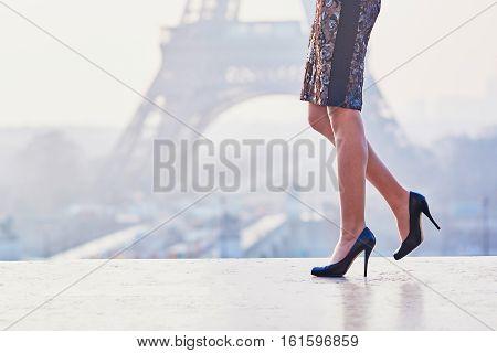 Woman Walking Near The Eiffel Tower