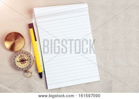 Compass, Pen And Notebook On Blank Paper, Travel Accessories Concept In Vintage Color Filtered.