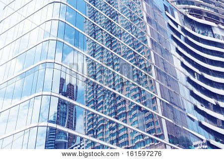 Glass Of Modern Tower With Sky Reflection For Business Background.