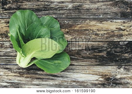 Image of a Bok Choy with a Wood Background