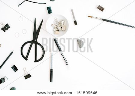 Flat lay top view office table desk. Workspace with scissors glasses pen on white background.