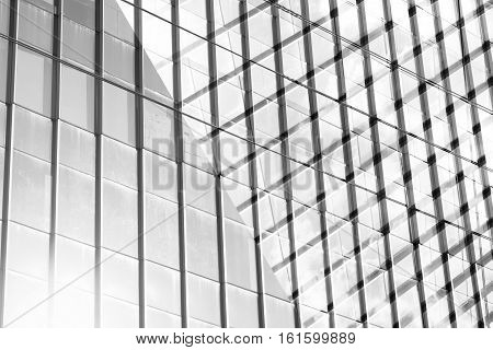 Hight Glass Modern Building For Abstract Background. Facades Texture Pattern For Business Background