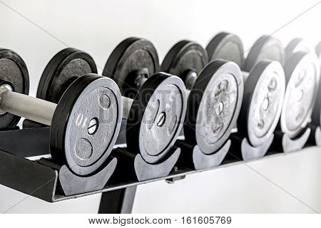 Sports dumbbells in sports club. Weight Training Equipmentwhite background