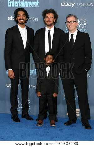 LOS ANGELES - DEC 11:  Dev Patel, Garth Davis, Sunny Pawar, Luke Davies at the 22nd Annual Critics' Choice Awards at Barker Hanger on December 11, 2016 in Santa Monica, CA
