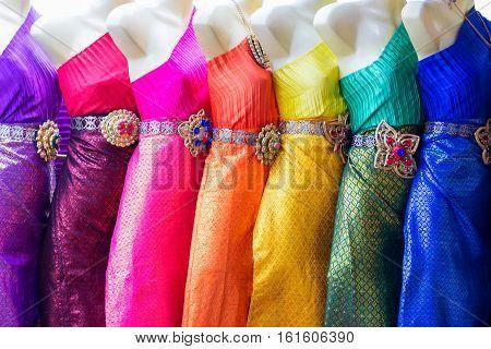 Colorful Thai traditional woman clothing near Wat Arun temple Bangkok Thailand.