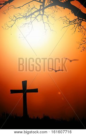 Silhouette of the cross and tree with blurred bird with flare at sunset.