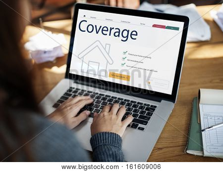Woman checking insurance coverage laptop