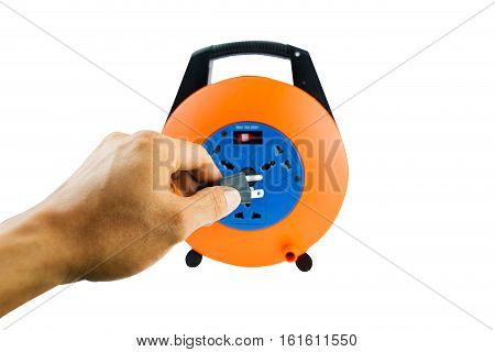 Hand with power supply out let plug extention cord isolated against a white background
