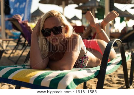 Woman Laying On The Chair Getting Sunbathe
