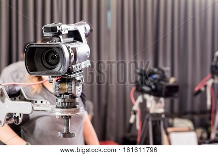 Digital Video Camera With Lens Equipment In Professional Media Studio