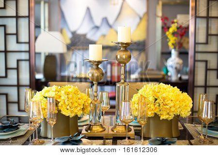 elegant crockery on dining table in modern dining room