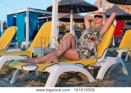 Woman Laying On The Chair Getting Sunbathe