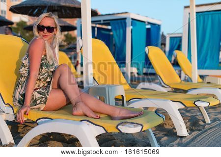 Beautiful Young Blonde Woman Sunbathe On The Beach