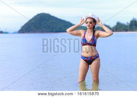 Bikini with women body sexy hat and sunglasses on Thung Wua Lan Beach at Chumphon Province Thailand