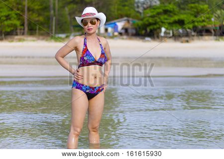 Bikini show women sexy hat and sunglasses on Thung Wua Laen Beach at Chumphon Province Thailand