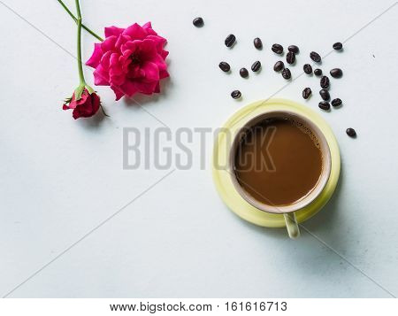 Coffee time with beauty pink flower on white desk of relaxation in morning break time holiday or weeknd Top view and copy space