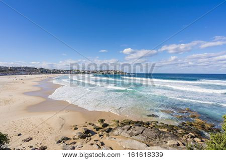 View of the Bondi beach and modern beachside apartments in Sydney, Australia during daytime