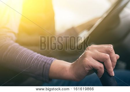 woman hands of a driver on gearbox of a car with copyspace