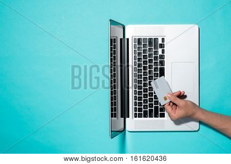 Top view of male hands making online payment