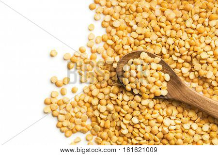 Yellow split peas isolated on white background.
