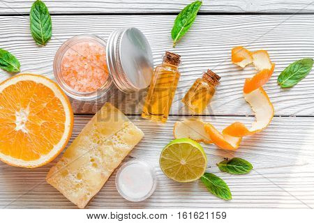 organic cosmetic with citrus on wooden background top view.