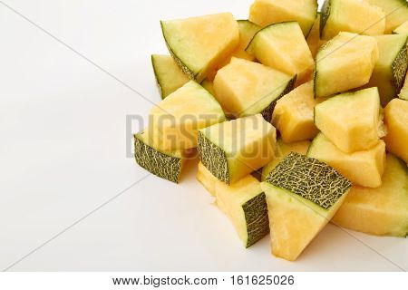 Hamigua Melon cut into slices Hami Melon Hami Cantaloupe isolated on white background.