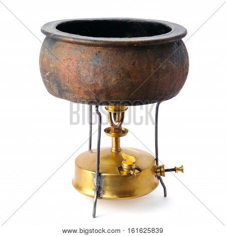 kerosene stove and a ceramic pot isolated on white background