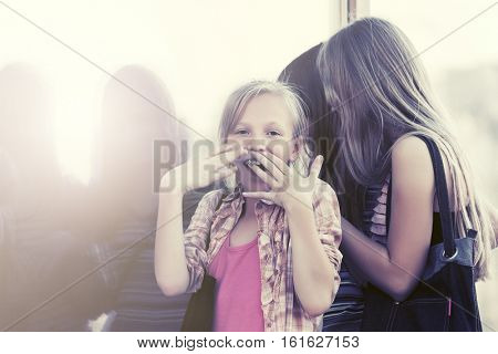 Group of teen girls looking through the mall window. Stylish fashion model outdoor