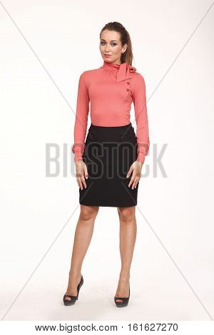 brown hair business executive woman with pony tail hair style in pink blouse and skirt high heel shoes going full body length isolated on white