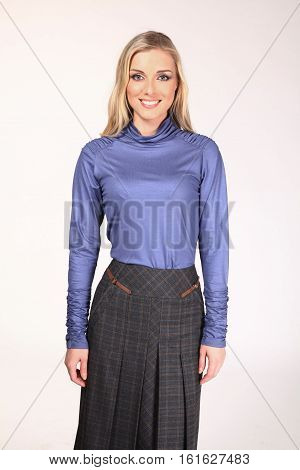 blond hair woman with straight hair style in blue blouse skirt close up photo isolated on white
