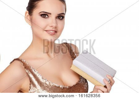 christmas, x-mas, winter, happiness concept - smiling woman in golden dress with gift boxes