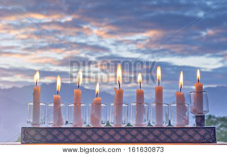 Jewish menorah with candles is traditional symbol for Hanukkah Holiday. Selective focus was applied