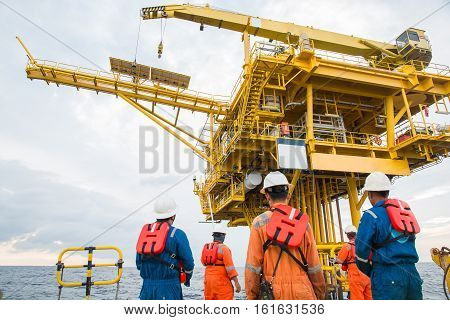workers on transport boat to offshore rig. industrial. energy. power oil and gas