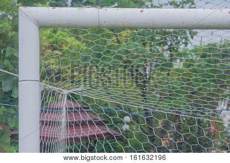 Corner or part of football goal in field.