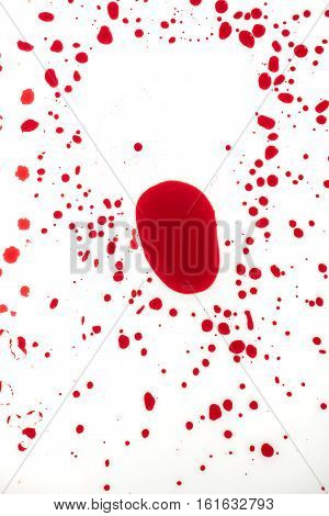 Blood drips on white surface abstract background for violence murder or crime scene