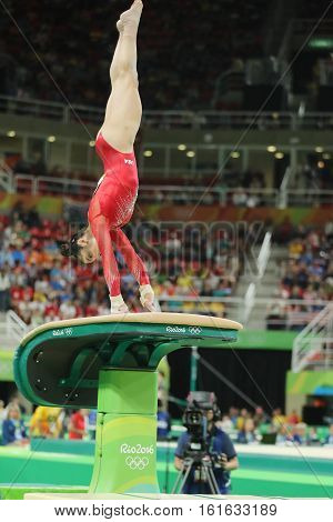RIO DE JANEIRO, BRAZIL - AUGUST 11, 2016: Olympic champion Aly Raisman  of United States competing a vault at women's all-around gymnastics at Rio 2016 Olympic Games
